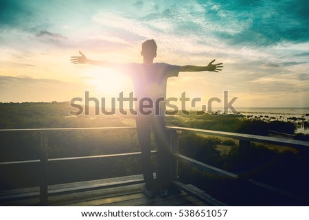 Silhouette freedom man rise hands up inspire good morning. Christian worship praise God in thanksgiving day Prayer Financial on terrace open arms motivate enjoy love concept vision wisdom hope. #538651057
