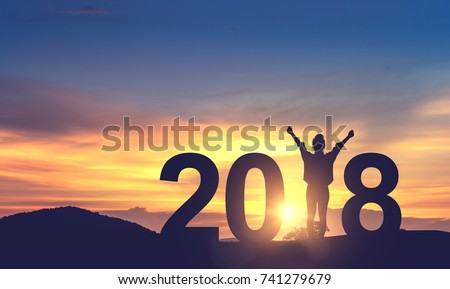 Silhouette freedom young woman Enjoying on the hill and 2018 years while celebrating new year, copy spce.