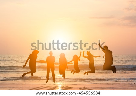 Silhouette friends jumping with joy and happiness over blurred, sand and sea. They love each other as longtime friends. I promise not to leave each other. Concept friends. concept happy.