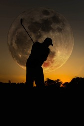 Silhouette golfer swing to the moon.