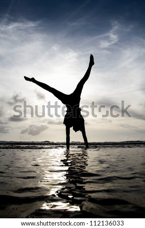 silhouette gymnast in water