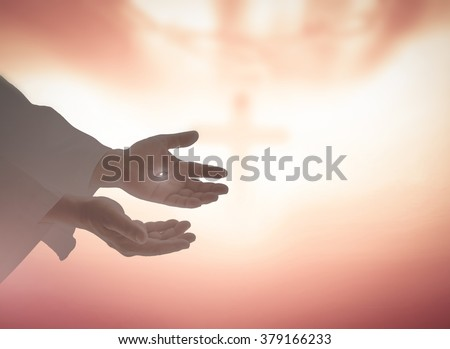 Silhouette hands of Jesus Christ open palm up and show scars on blur cross with crown of thorns background. Resurrection Humble Eucharist Blessed Christian Give Nail Religion Maundy Thursday concept.