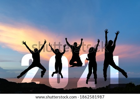 Silhouette happy business teamwork jumping congratulation and celebrate in Happy New year 2021 for change new life future concept. Freedom lifestyle group people team jump as part of Number 2021  商業照片 ©