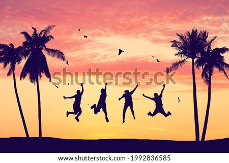 Silhouette happy friends jumping on sunset sky at tropical beach with palm tree and birds flying abstract background. Copy space of feel good freedom and travel adventure concept. Vintage tone color.