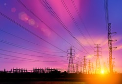 Silhouette High voltage electric tower  on sunset time and sky on sunset time background.