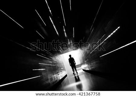 Silhouette human in the center of beautiful corridor design. #421367758