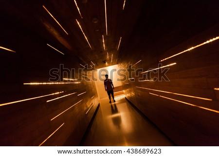 Silhouette human in the center of beautiful corridor design. #438689623