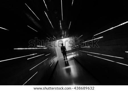 Silhouette human in the center of beautiful corridor design. #438689632