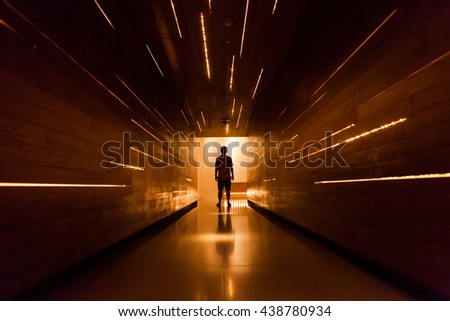 Silhouette human in the center of beautiful corridor design. #438780934