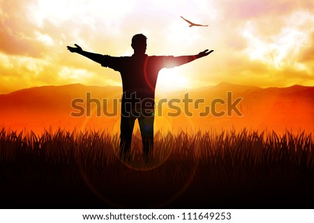 Silhouette illustration of a man standing on grass field with open arms facing the sun