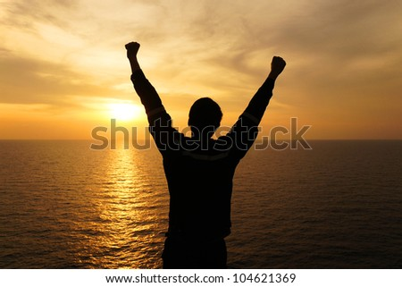 Silhouette Image of Man Raising His Hands - Signs of Successful and Happiness