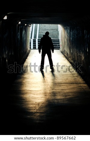 silhouette in a subway tunnel