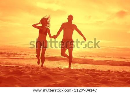silhouette in love sunset sea / newlyweds in honeymoon at sea, vacation luck summer sea beach, silhouette couple at sunset #1129904147