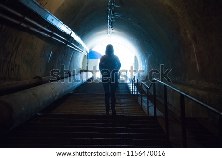 Silhouette in the dark tunnel with light at the end. #1156470016