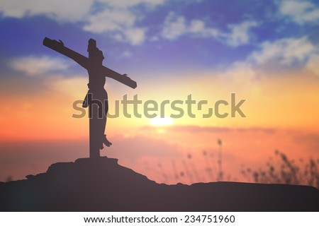 Silhouette Jesus and the cross over blurred sunset background. Christmas background, Worship, Forgiveness, Mercy, Humble, Repentance, Reconcile, Adoration, Glorify, Peace concept.