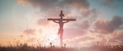 Silhouette Jesus christ crucifix on cross in sunset good friday risen in Resurrection Sunday easter day concept for Christian praise for holy spirit religious God, Catholic church landscape background