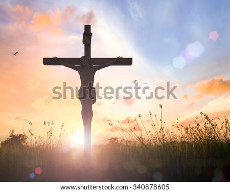 Silhouette Jesus Christ with cross on blur beautiful autumn sunset with amazing light background. Thanksgiving, Redeemer, Forgiveness, Mercy, Repentance, Adoration, Glorify, Love, Grace, Bible concept