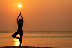 Silhouette lifestyle woman yoga exercise healthy life. Young girl or people pose balance body vital zen and meditation workout and fitness sport outdoor sunset near the beach. Sea background.