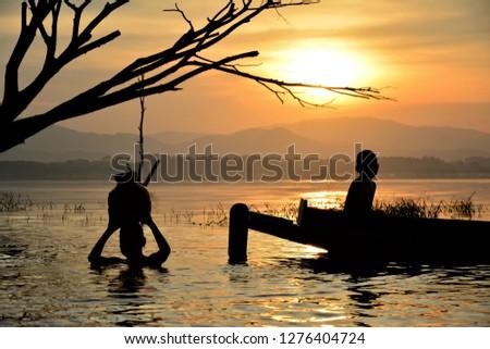 Silhouette Livelihoods of fishermen casting fish in the reservoir