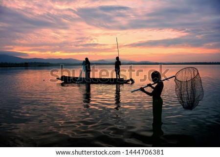 Silhouette Livelihoods of fishermen casting fish in the reservoir