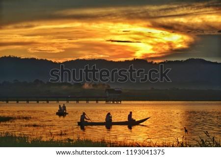 Silhouette livelihoods on the boat in reservoir