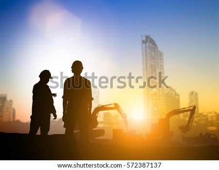 Silhouette machinery work construction road plan to connect over blurred natural background sunset pastel. Heavy industry and safety at work concept. support transportation business and journalism.
