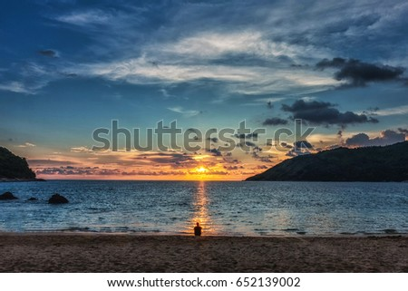 Shutterstock Silhouette man enjoying sunset evening together on the beach.
