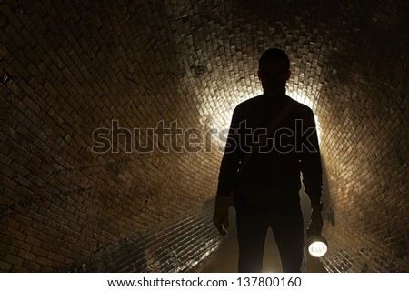 Silhouette man in underground old sewage treatment plant. #137800160