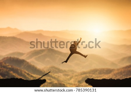 Silhouette Man Jump On Beautiful View And Broken Chain Freedom Concept Or Business Victory