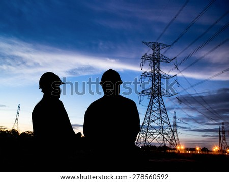 silhouette man of engineers standing at electricity station