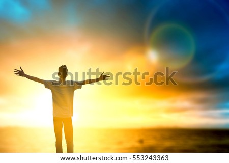 Silhouette man thought positive rise hand on the beach background. Christian worship God on thanksgiving day Good man standing motivated up for wellbeing open arms over nature sun concept hope spirit  #553243363