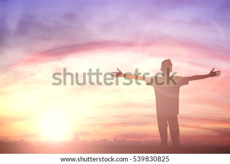Silhouette man with hands rise up on beautiful view. Christian praise on hill thanksgiving day background. Now one man standing on peak open arms enjoying nature the sun concept world wisdom fun hope #539830825