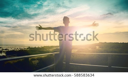 Silhouette man with hands rise up on beautiful view. Christian praise on hill thanksgiving day background. Now one man standing on peak open arms enjoying nature the sun concept world wisdom fun hope #588583634