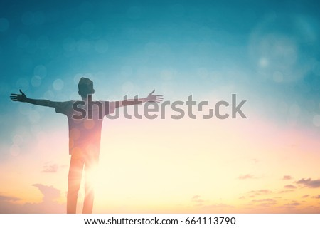 Silhouette man with hands rise up on beautiful view. Christian praise on hill thanksgiving day background. Now one man standing on peak open arms enjoying nature the sun concept world wisdom fun hope #664113790