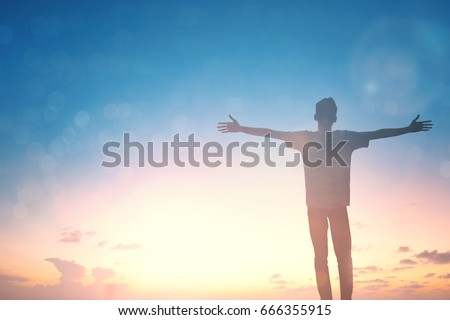Silhouette man with hands rise up on beautiful view. Christian praise on hill thanksgiving day background. Now one man standing on peak open arms enjoying nature the sun concept world wisdom fun hope #666355915