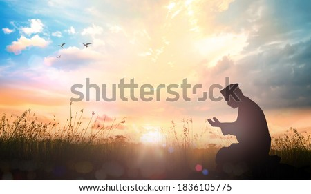 Silhouette muslim dua to Allah over meadow sunset background  Stok fotoğraf ©