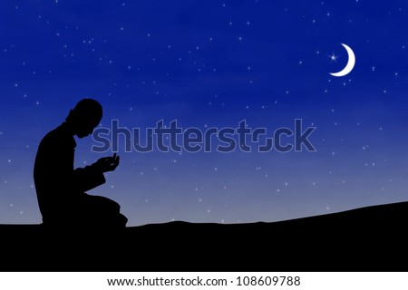 Silhouette muslim man praying at night with moon background during the month of ramadan