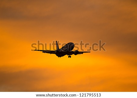 Silhouette of a aircraft approaching the airport.