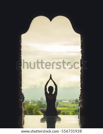 silhouette of a beautiful yoga...