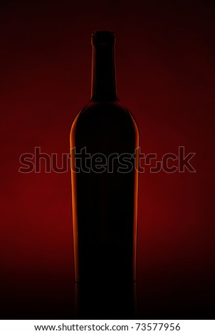Silhouette of a beer bottle against a dark background #73577956