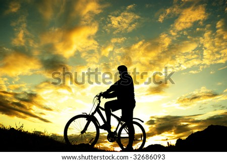 Silhouette of a biker standing