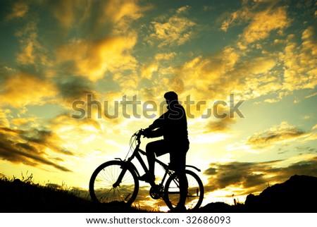 Silhouette of a biker standing