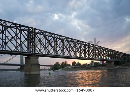 Silhouette of a bridge in Belgrade at sunset.