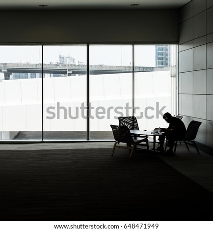Silhouette of a businessman are thinking about plan. #648471949