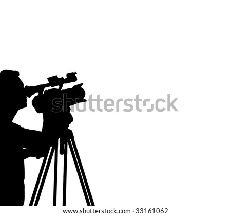Silhouette of a Cameraman Filming