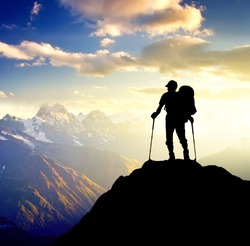 Silhouette of a champion on the high mountain. Sport and active life