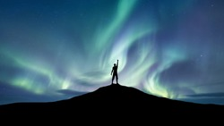 Silhouette of a championat the northen light background. Sport and active life concept and idea of success