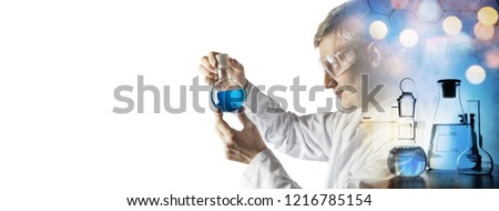 Silhouette of a chemist and biotechnologist conducting experiments on the background of Scientific Glassware. Concept on education, chemistry and science topics. Chemical background.
