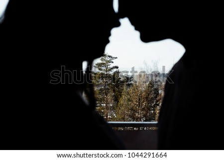 silhouette of a couple in love #1044291664