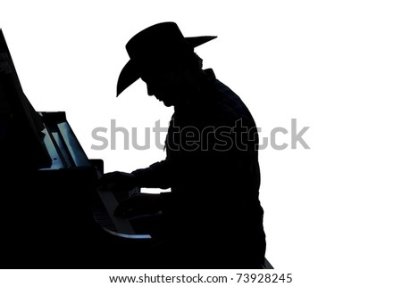 Silhouette of a cowboy paying the piano isolated on white